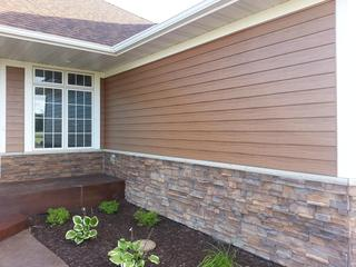 """This rambler in Minnesota chose EDCO's Single 6"""" Traditional Lap Siding in Cedarwood HD to achieve a natural wood grain appearance on their home without the maintenance required with real wood siding. In addition, Glacier White trim was installed to accent the homes beauty."""