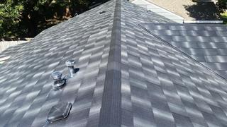 The stunning beauty and best industry lifetime warranty with EDCO's Infiniti Textured Shake Roofing panel in Obsidian were the top two reasons why this homeowner chose to install this award-winning product.