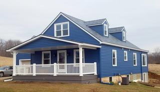 Stunning rural home the is complete with EDCO from top to bottom: Prism Traditional Lap Siding in Sapphire and the award-winning Infiniti roofing in Granite Gray Enhanced