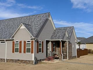 A rural home selected EDCO's Arrowline Shake Charcoal Gray Enhanced roofing for their home because of its durability and lifetime warranty.