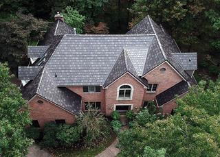 "This beautiful home became stuffing after the installation of EDCO's ArrowLine Slate Statuary Bronze roofing. Gives it the ""WOW"" factor!"