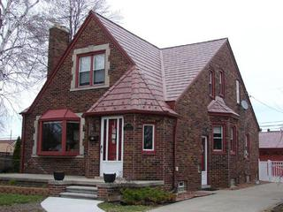 The charm of this historical home was kept intact with the selection and installation of EDCO Slate Siding in Classic Red Blend to complement the brick structure