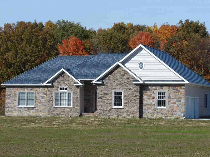 This beautiful rambler in rural Michigan with unqiue charm features the Arrowline Slate Stone Blend Roofing which achieves the look of natural slate for a fraction of the weight and cost