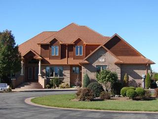 Generations Copper Shake roofing blends into the overall color tones on this home to give it everlasting style