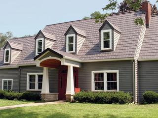 The homeowners of a cottage style home in Wisconsin chose EDCO's Arrowline Shake Statuary Bronze Roofing because it provided them with peace of mind, knowing that their home will retain the natural look of the home which is backed by an unmatched industry warranty.