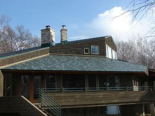 This Minnesota home located along the St. Croix River selected Arrowline Shake Hartford Green Blend Roofing which matches the character and outdoors nature setting of the home