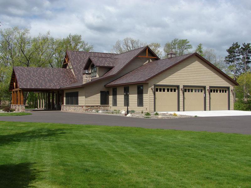 Located in rural Wisconsin, this ranch-style home selected Arrowline Shake Royal Brown Blend Roofing because of its impact resistance, which is the highest impact rating available