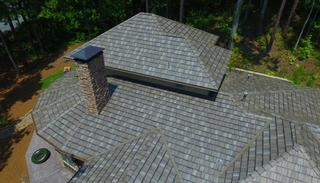 Arrowline Enhanced Shake T-Tone Blend Roofing was selected for this home in a rural wooded area in Alabama to give the roof a weathered look to compliment the environment surrounding the home.