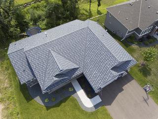 The beautiful Infiniti Textured Shake roofing in Granite Gray Enhanced added character to this neighborhood.