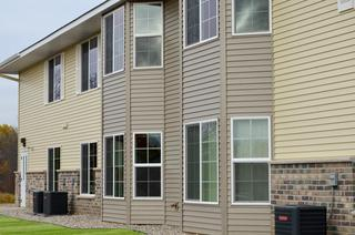 Two complimentary siding colors were installed at an apartment building in Minnesota to give it a distinctive look.