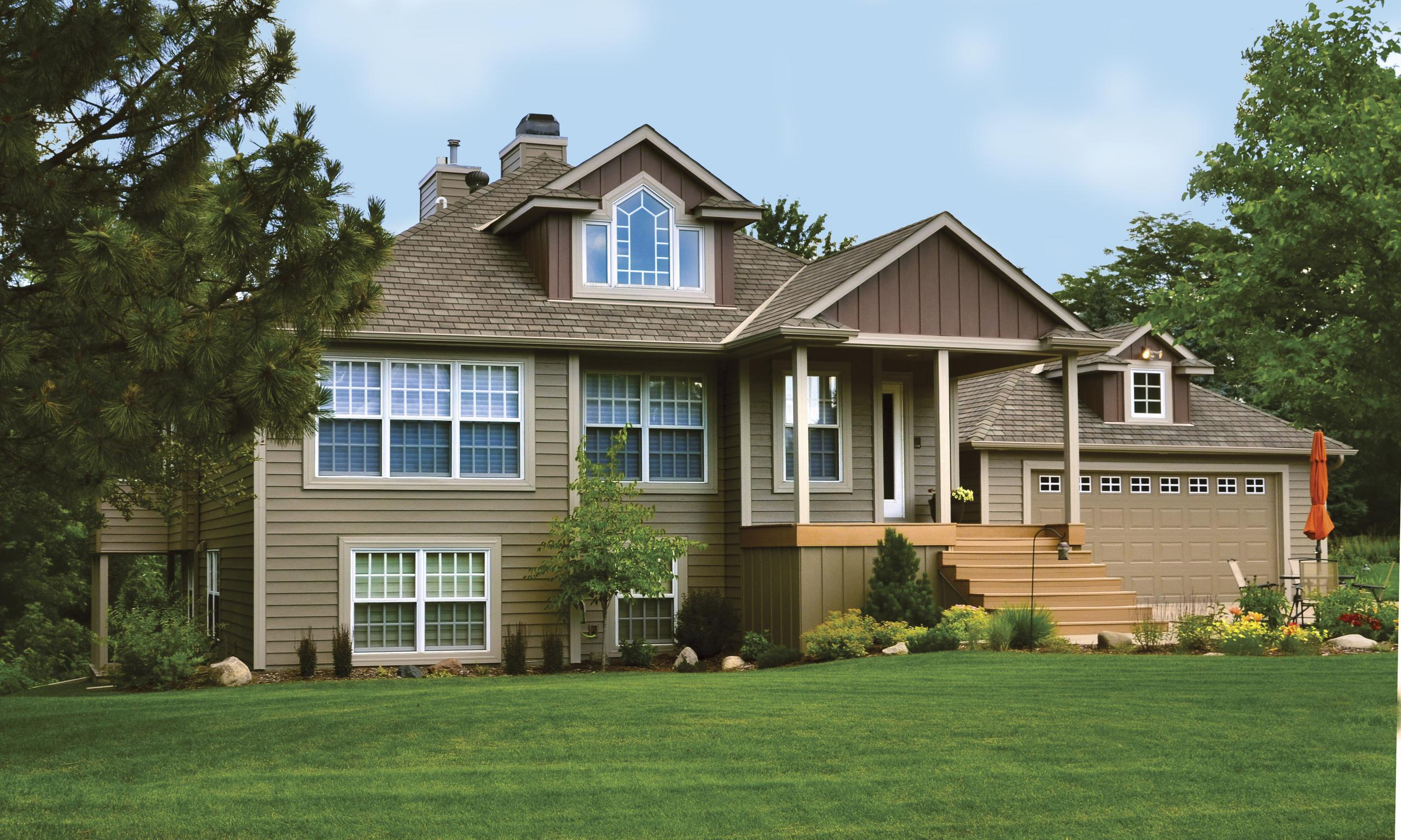 "Vertical 12"" Board and Batten in Mahogany gives this home beauty as it color-coordinates with EDCO's Single 6"" Traditional Lap Siding and Soffit, Fascia and Trim which is also from EDCO"