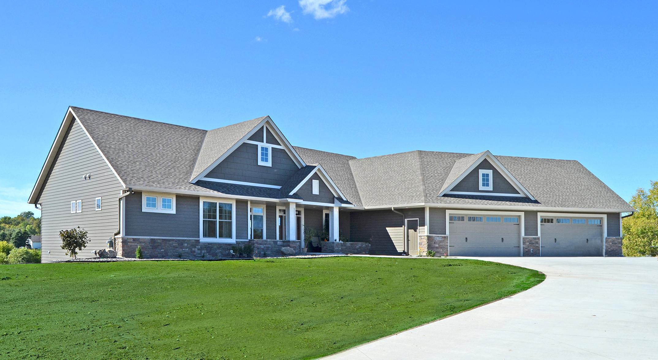 """Charm and everlasting beauty are found on this home after the installation of EDCO's steel Single 6"""" Traditional Lap Siding in T-Tone."""