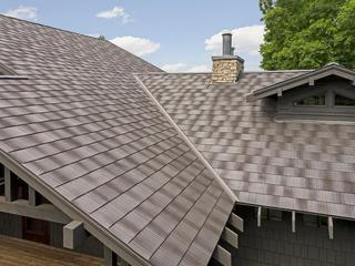 A unique rustic appearance of Infiniti Roadhouse roofing gives this home additional personality.