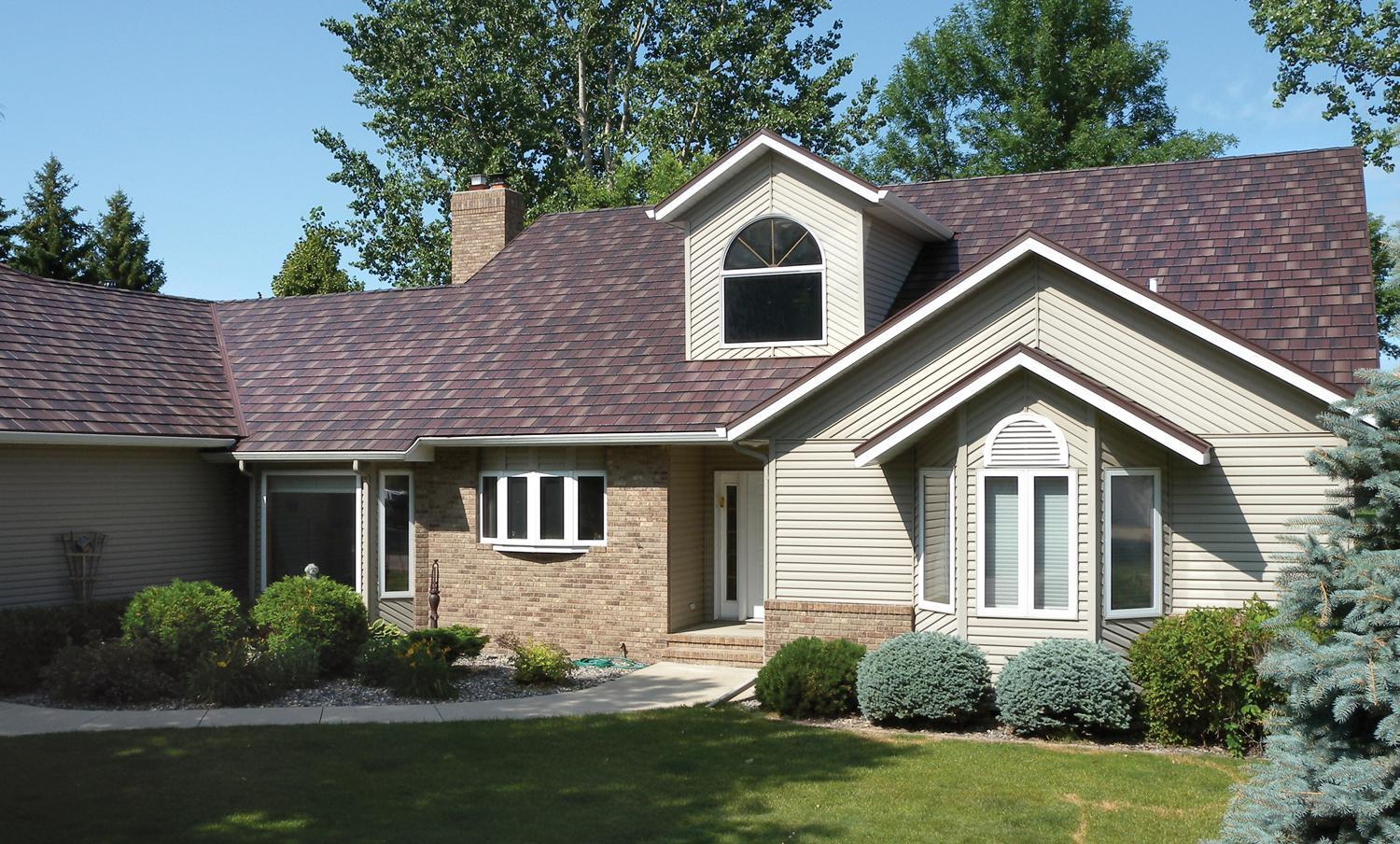 EDCO's Arrowline Shake Royal Brown Blend Roofing offers this rambler a distinctive look that coordinates with the brick and siding color on the home