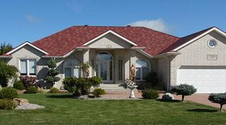 The base red color with contrasting light and dark tones, in addition to dark shadow lines and keyways, give definition to this homeowners roof in Arrowline Enhanced Slate Classic Red Blend