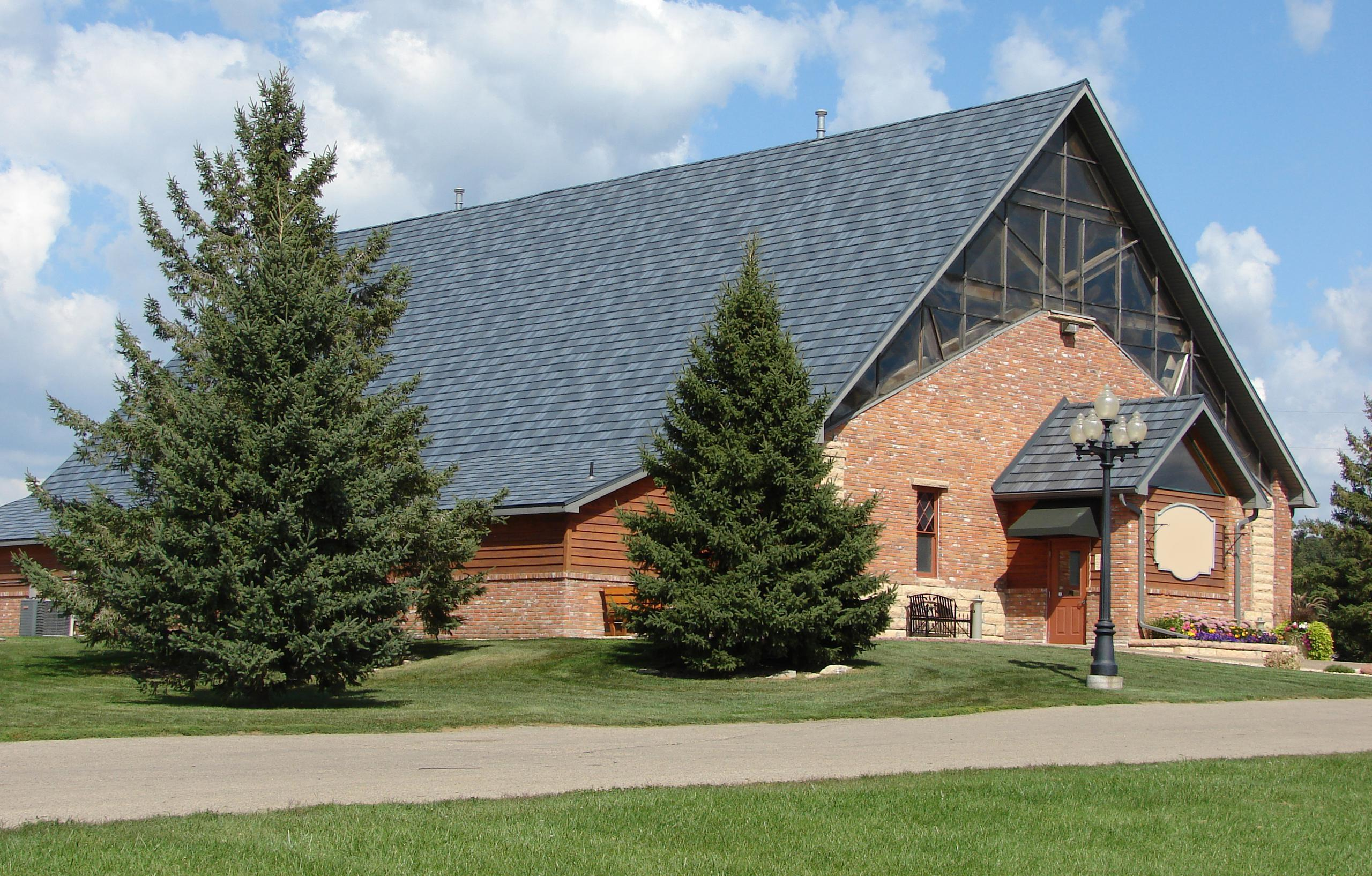 Architectural appeal was added to this charming church building when the EDCO Arrowline Slate Stone Blend Roofing was installed.