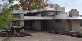 The natural look of a slate roof in t-tone blend enhances the unique architecture of this home in the Twin Cities.