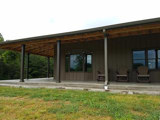 """This rural home shows the beauty of Board and Batten 12"""" siding in Canyon with complemented by T-Tone Trim."""