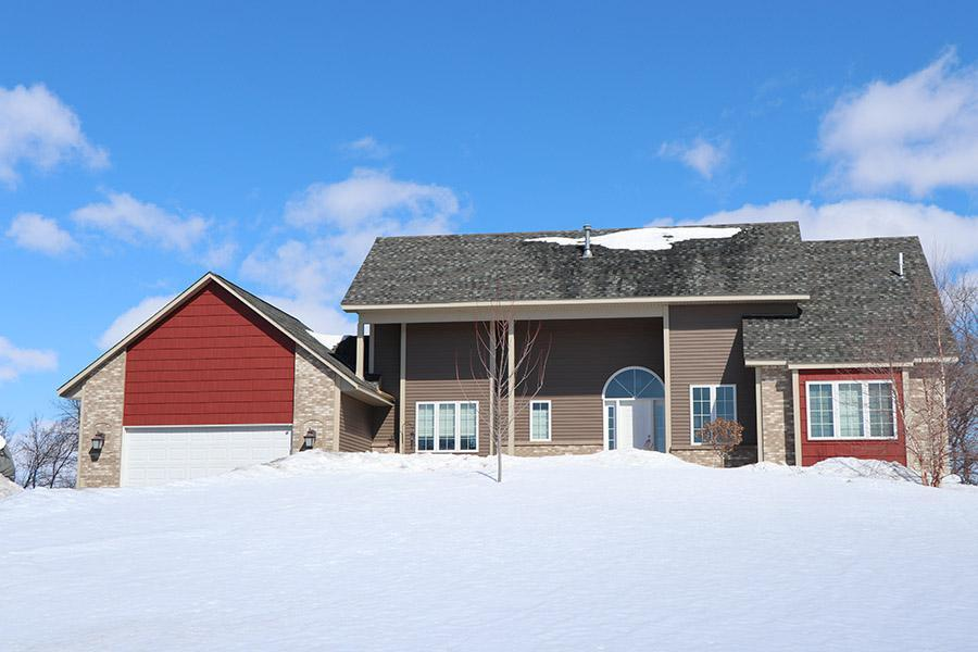 """This stunning single-family home incorporated EDCO's Double 4"""" siding in Timber along with EDCO's Arrowline Shake in Classic Red to give the home a perfect accent."""