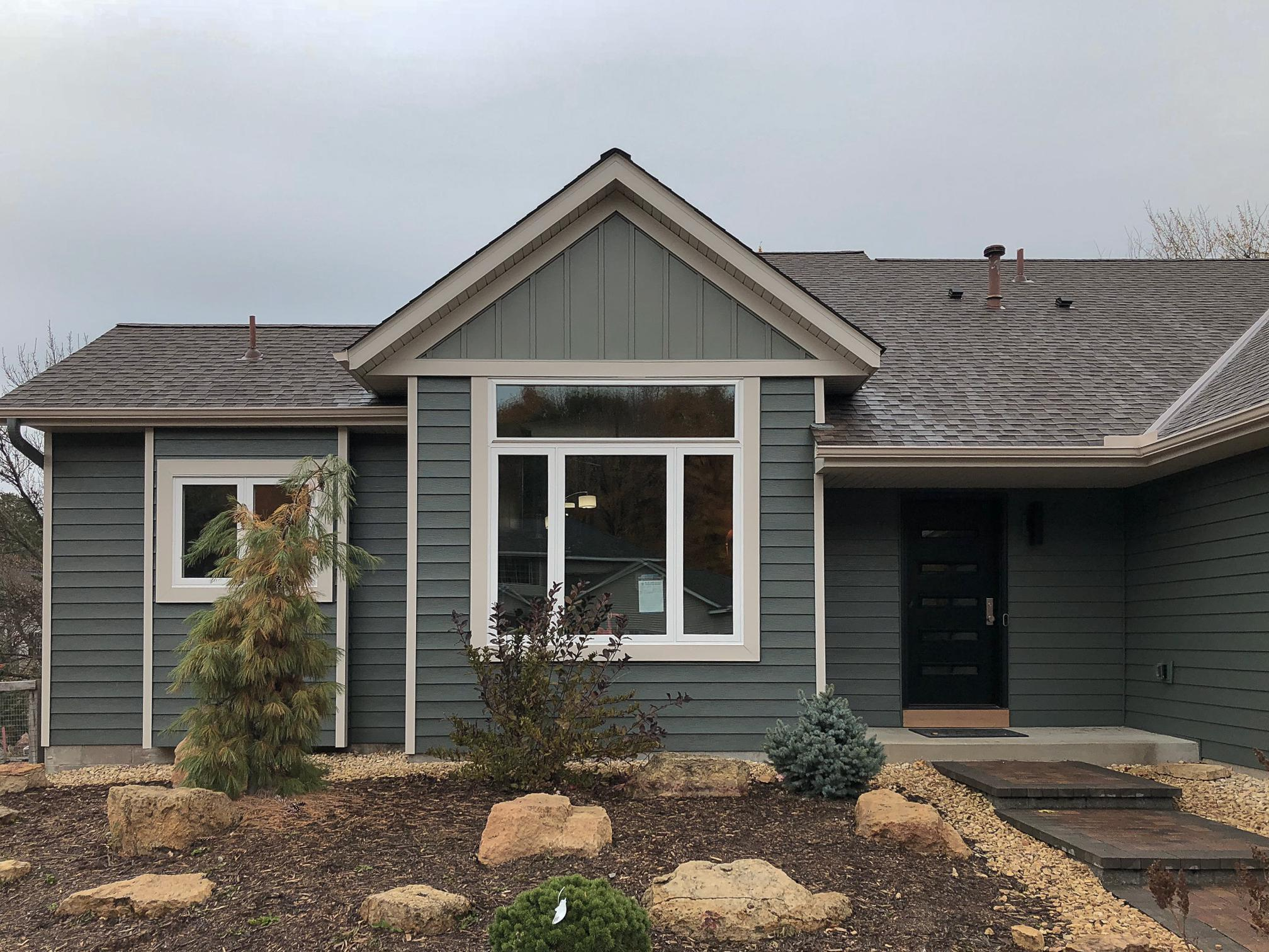The homeowners of this rambler home in the Twin Cities chose EDCO's Traditional Lap Siding in Willow and Board and Batten in Sage to give their new home timeless style.