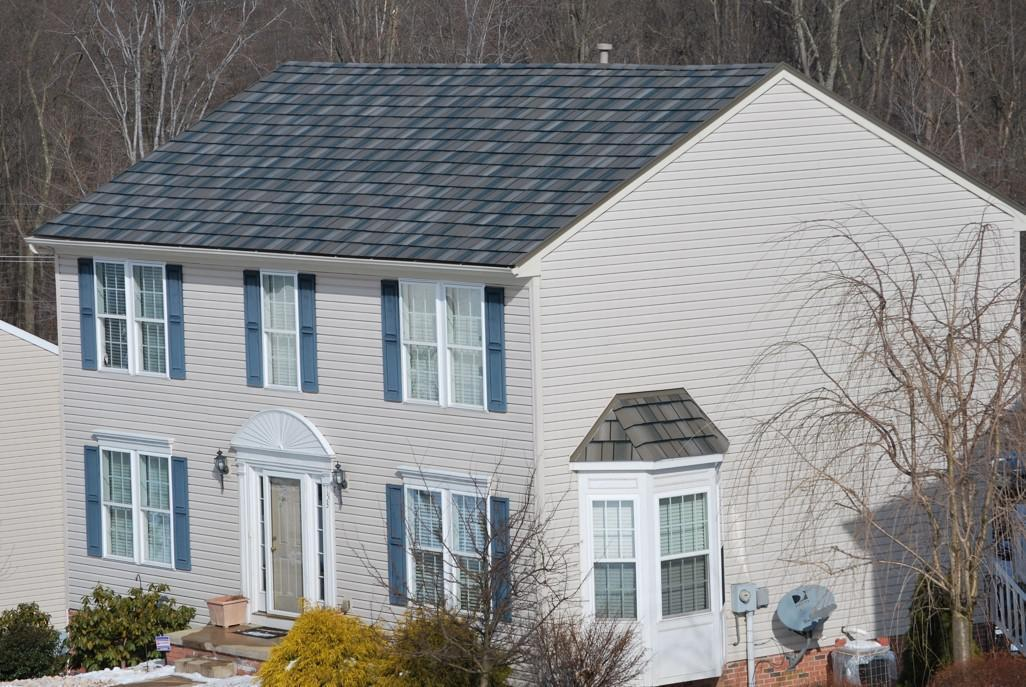 Arrowline Enhanced Shake T-Tone Blend Roofing was chosen to further accent the homes distinct features.