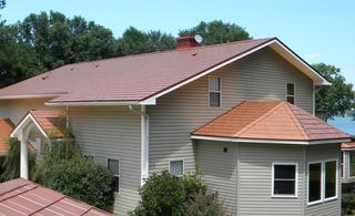 The homeowner of this two-story home selected EDCO's Generations Shake Copper for their roof as a result of the materials Cool Roof Technology which reflects sunlight and absorbs less heat  than the typical asphalt roofing material