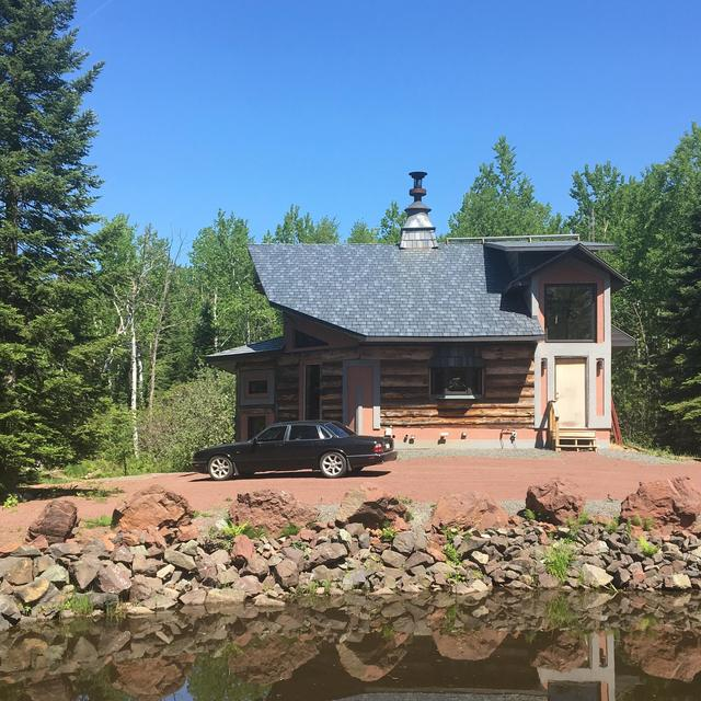 This cabin owner selected Stone Enhanced Slate Roofing to give it unique charm and character in the outdoors.
