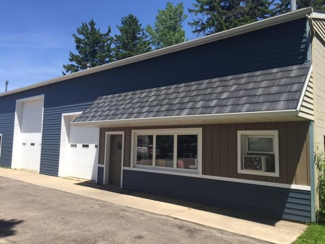Award-winning Infiniti Textured Shake in Obsidian was installed on the canopy covering the front of a small business. The Infiniti roofing product was selected because of its cool roof technology that reflects sunlight and absorbs less heat than typical asphalt roofing material