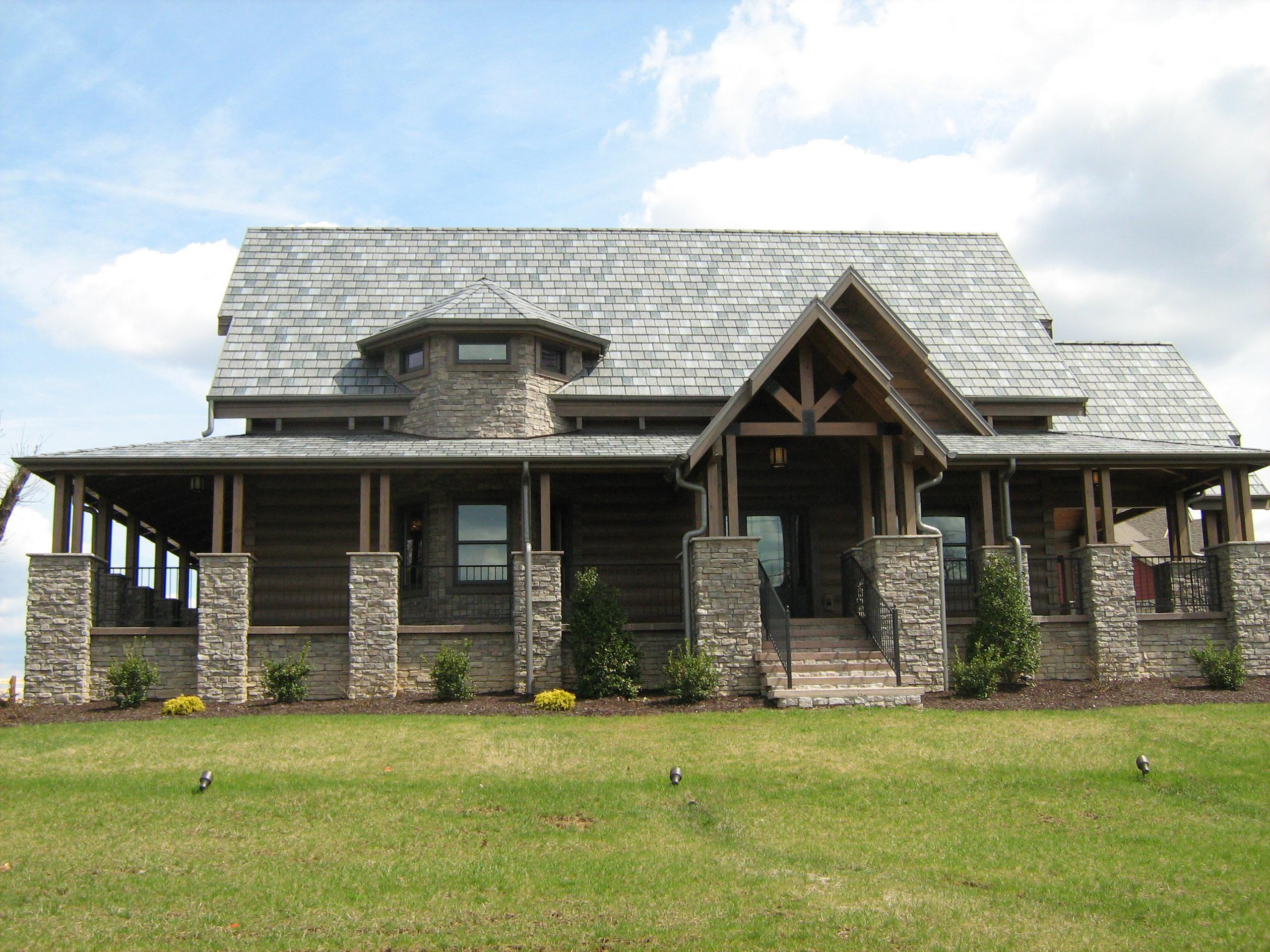 The Arrowline Slate T-Tone Blend Roofing offers quality and style to the stunning look of this log cabin home.