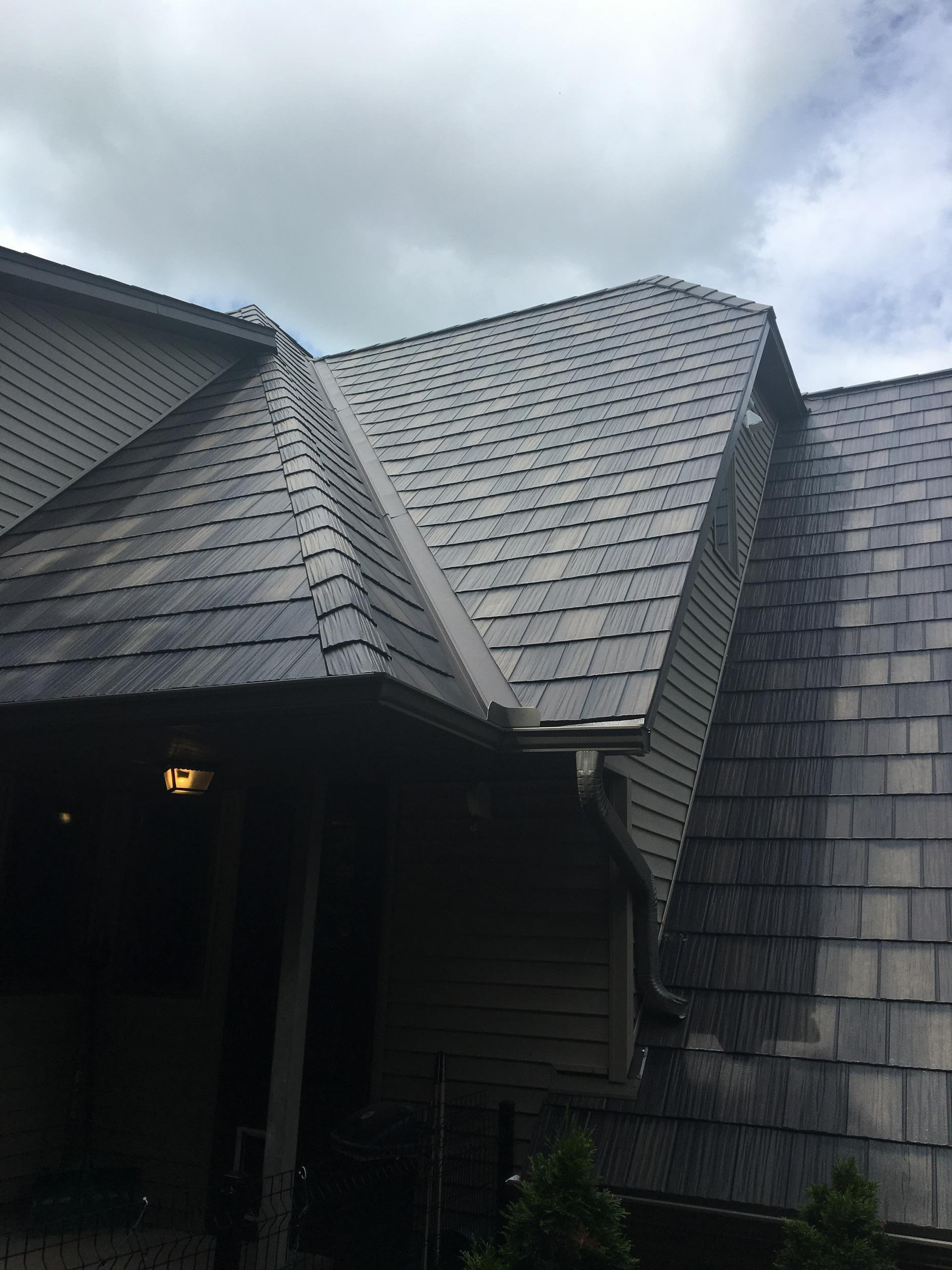 ArrowLine Statuary Bronze Enhanced Shake roofing gives this home quality and style that is everlasting.
