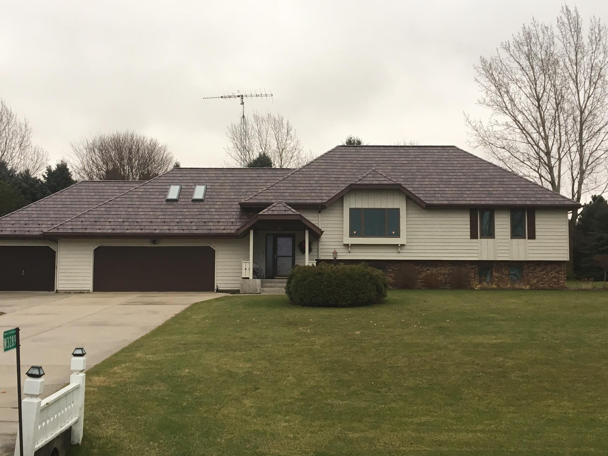 This single-family home showcases the beauty of EDCO's ArrowLine Royal Brown Enhanced Slate roofing.