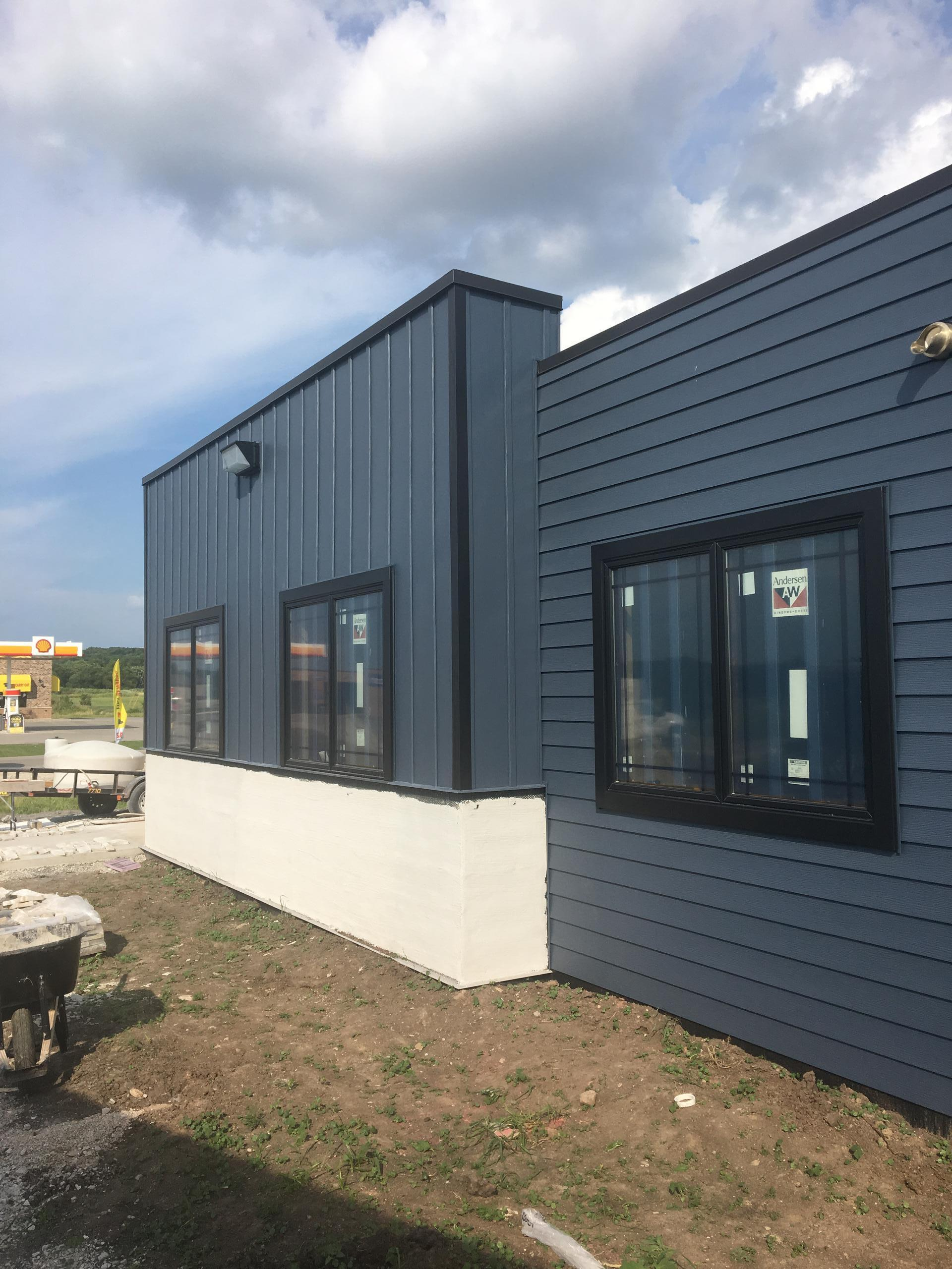 "This new building incorporates 6"" and Vertical 12"" Classic Blue siding along with black trim from EDCO."