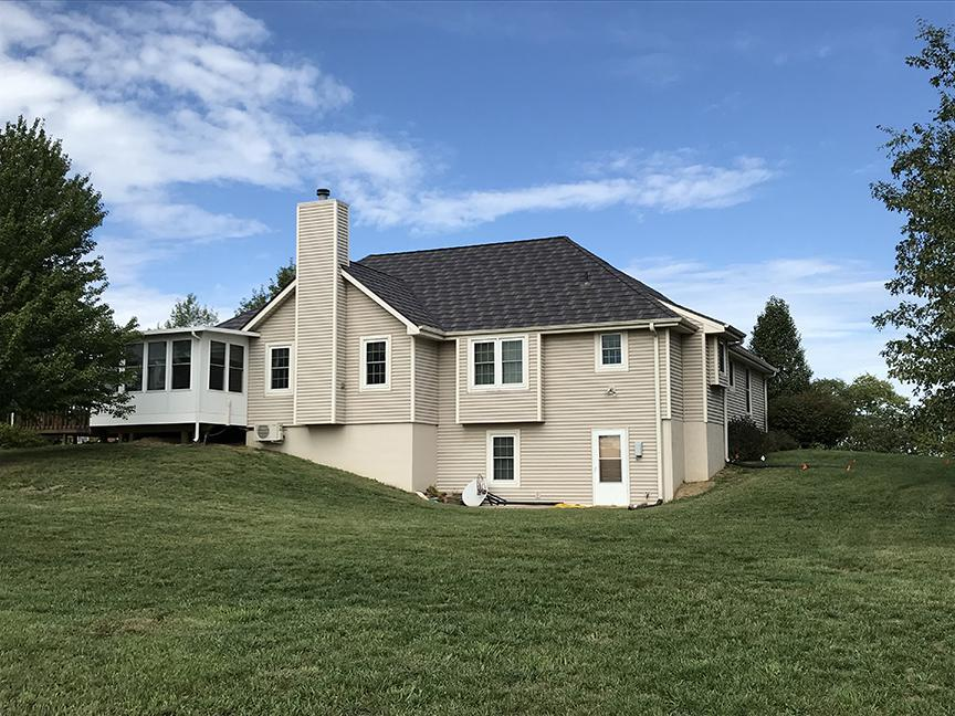 The homeowners of this rural home chose EDCO's award-winning Infiniti Roofing in Aged Bronze Enhanced because of its durability and sustainability.