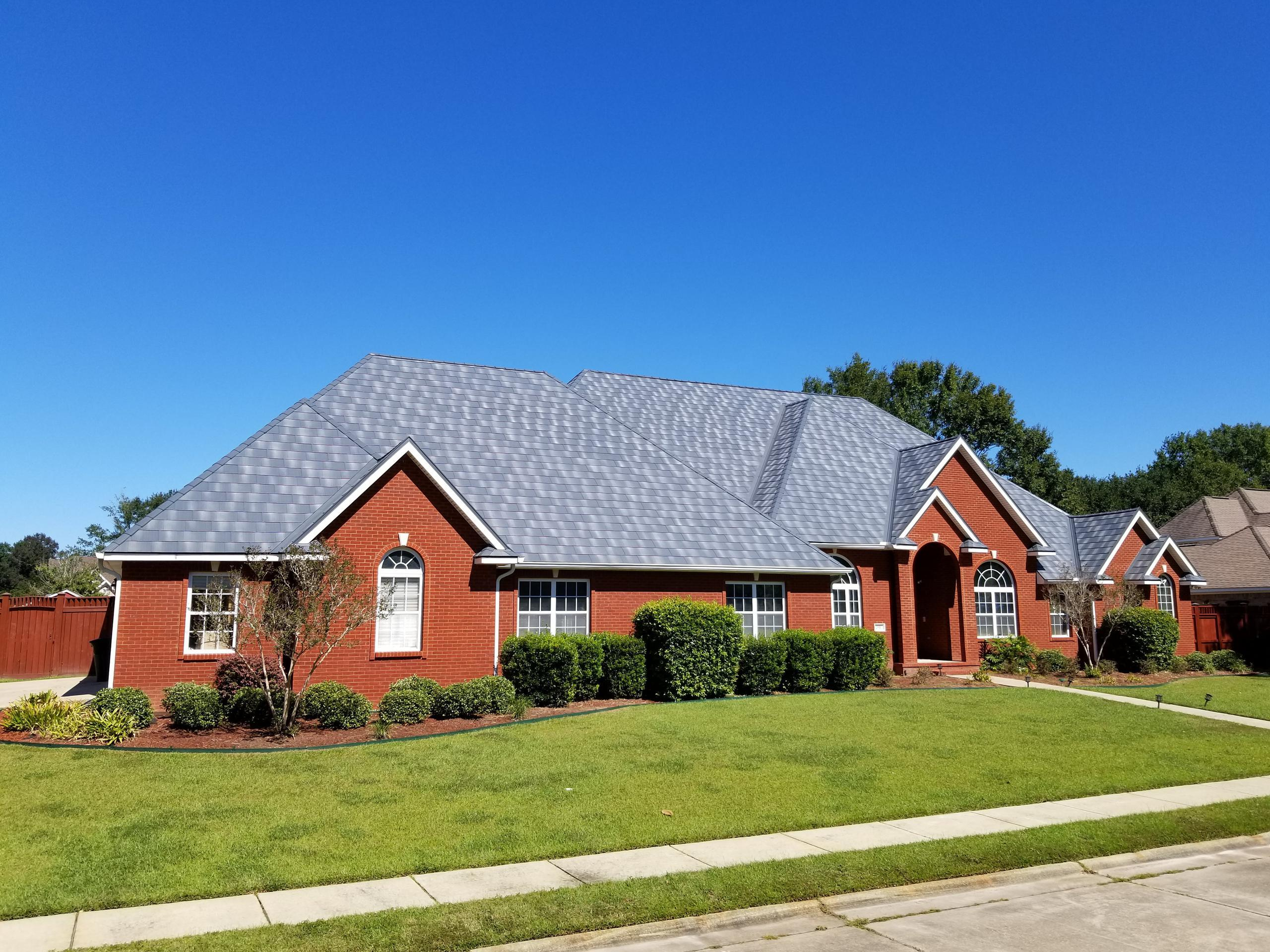 The award-winning Infiniti roofing from EDCO in Granite Gray Enhanced was selected for this red brick home to give it a distinctive appearance the is unmatched,