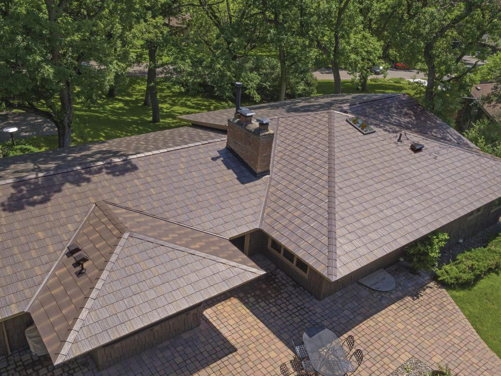 The award-winning Infiniti Textured Shake, the most technolgically advanced roofing panel in the industry, was selected to replace an existing roof because of its unmatched durability and performance