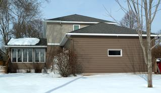 The Sandtone Timber Siding on this Minnesota home gave it unique charm and the natural look desired by the homeowner.