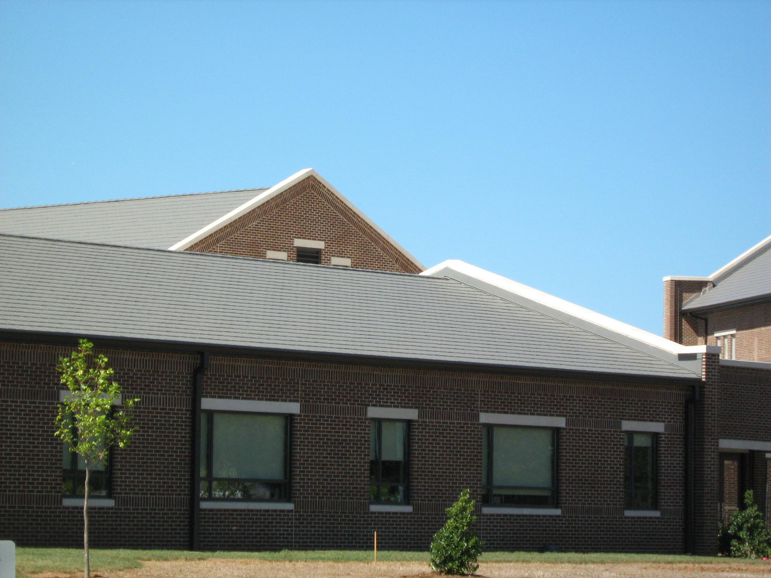 An education building attached to a church selected Arrowline Shake Charcoal Gray Roofing from EDCO to cooridnate with the stunning beauty of the church architecture.