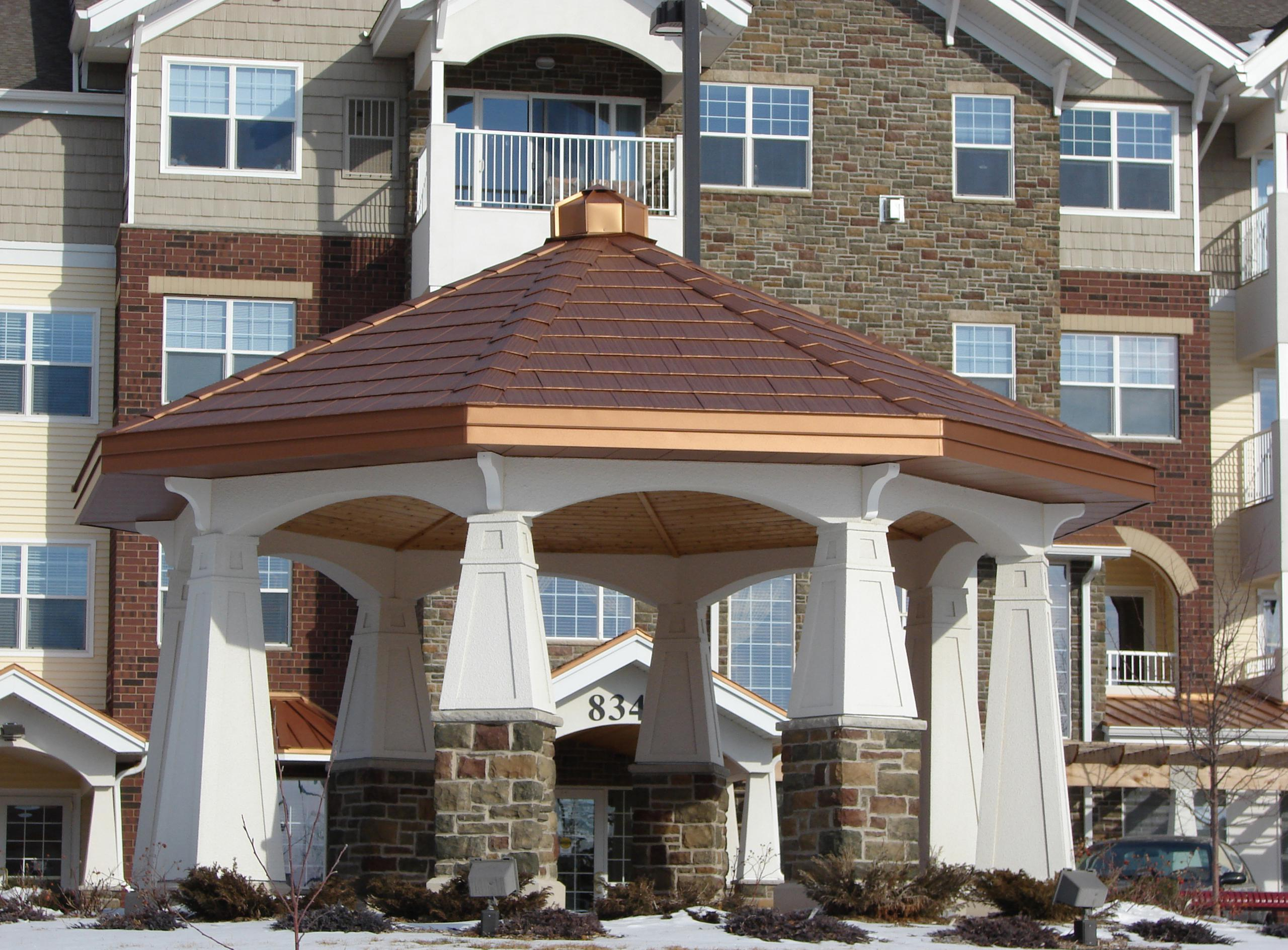 The gazebo located on the property of an apartment complex installed Arrowline Shake Copper Roofing to further accent the distinct features and architecture of the building.