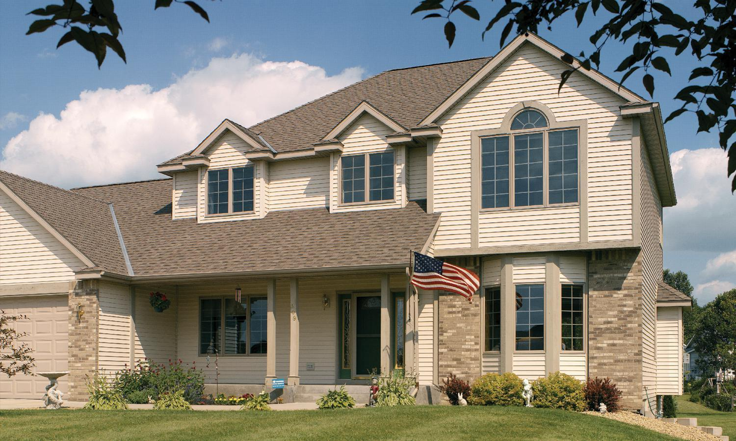 D4 Traditional Lap siding in Wickertone provides for a timeless look that completes the exterior of this home